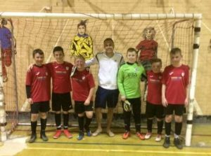 Team coach Matty Payne with his YMCA All Stars team who have just gone 11 matches without defeat in u12/13 league. Bright group of players lucky to be with a top coach who shares their futsal passion.